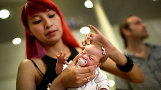 Delightful or disturbing? Life-like baby dolls on display in Spain