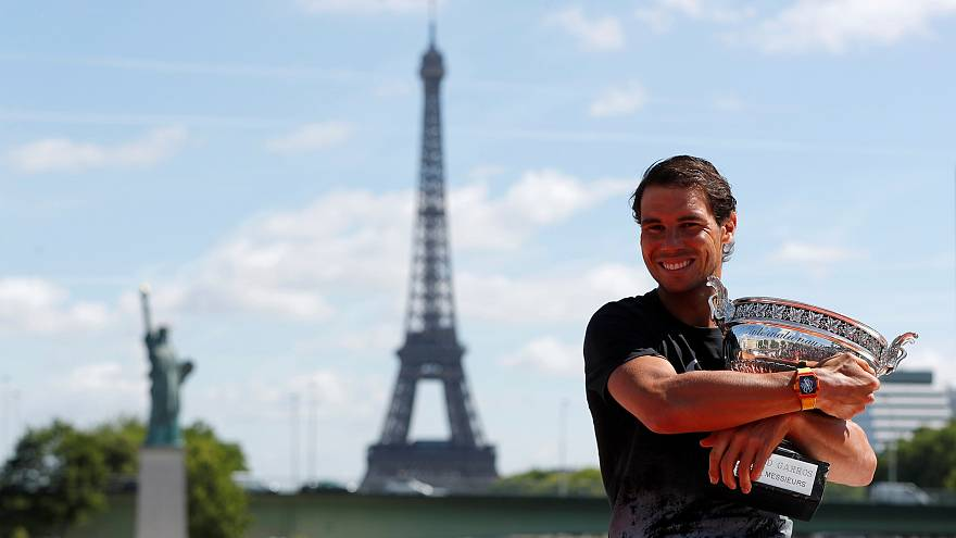 French Open champion Rafael Nadal relaxes with his trophy, the 10th Roland garros title of his career