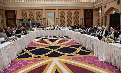 Qatari officials participate in peace talks in an undisclosed location in Doha, Qatar, on Feb. 25, 2019. U.S. Special Representative for Afghanistan, Ambassador Zalmay Khalilzad, is seen, second left, and the Deputy Commander of the Taliban Movement for Political Affairs, Abdul Ghani Baradar, right.