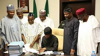 Nigeria's acting president signs record $23 bn 2017 budget into law