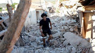 Shattered Lesbos surveys ruins after earthquake