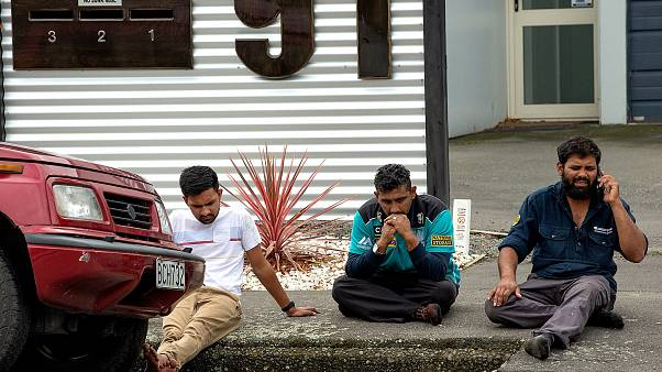 Image: Grieving members of the public following a shooting at the Al Noor m