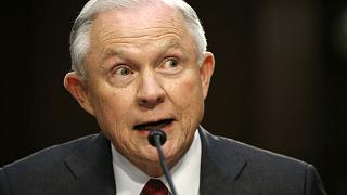 Feisty, tight-lipped Sessions denies improper Russia contacts