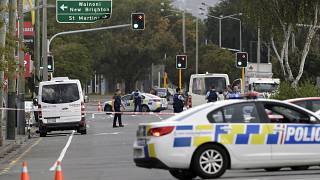 Image: Police stand outside a mosque in Linwood, Christchurch, New Zealand,