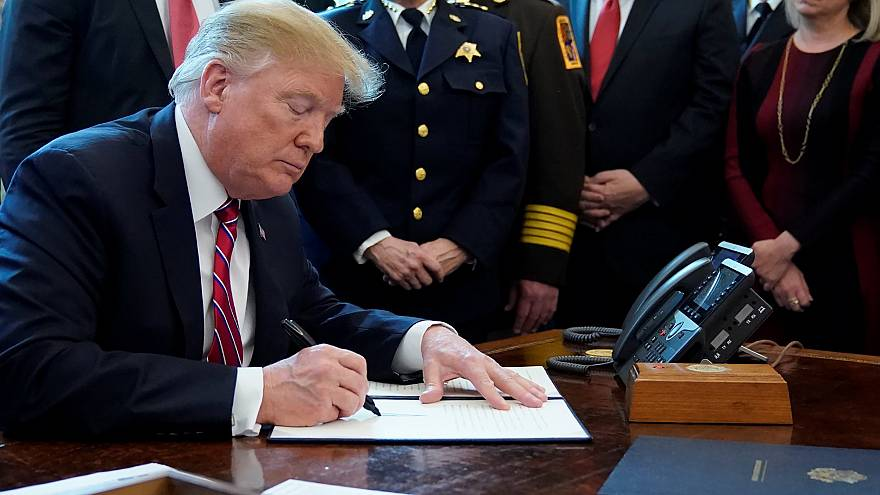 Image: President Donald Trump signs veto of congressional resolution to end