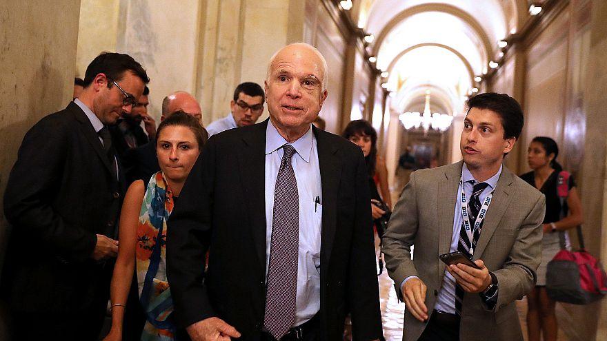 Image: Sen. John McCain, R-Ariz., leaves the Senate chamber at the U.S. Cap