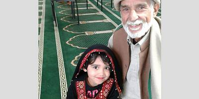 Haji Daoud Nabi with his granddaughter.