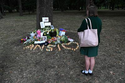 A student pays respect at a memorial site for the victims of mosque attacks in Christchurch on Tuesday.