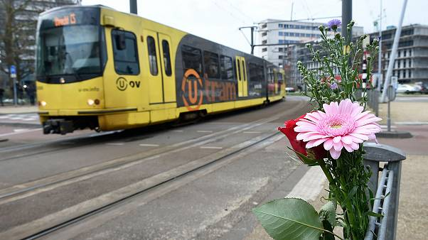 Image: Flowers have been set up in tribute to victims at the site of a shoo