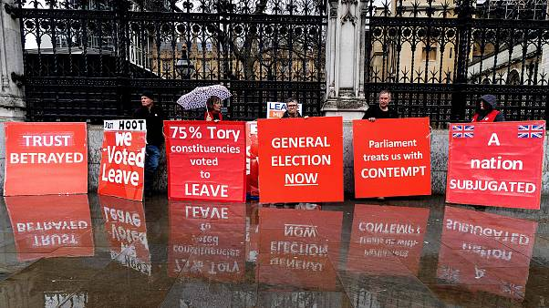 Image: Pro-Brexit activists hold placards as they demonstrate outside the H
