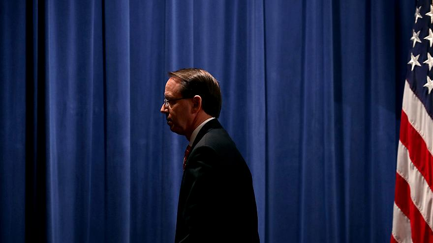 Image: Deputy Attorney General Rod Rosenstein leaves a news conference at t