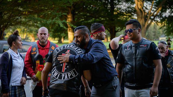 Image: Members of biker gangs arrive before performing the haka in front of