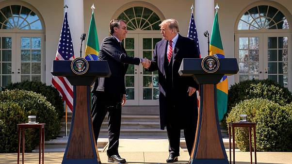 Image: Brazil's President Jair Bolsonaro and President Donald Trump shake h