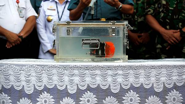Image: The cockpit voice recorder from Lion Air JT610 in a special containe