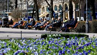 Image: FILE PHOTO: People enjoy a sunny day at the Esplanade in Helsinki
