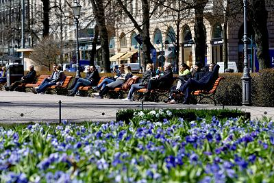People enjoy a sunny day at the Esplanade in Helsinki, Finland on May 3, 2017.