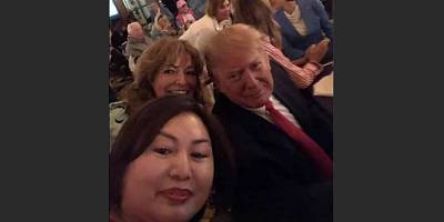 First reported by the Miami Herald, a photo on the Facebook page of Li Yang showed her posing with President Donald Trump at a Super Bowl watch party at the president\'s West Palm Beach country club.