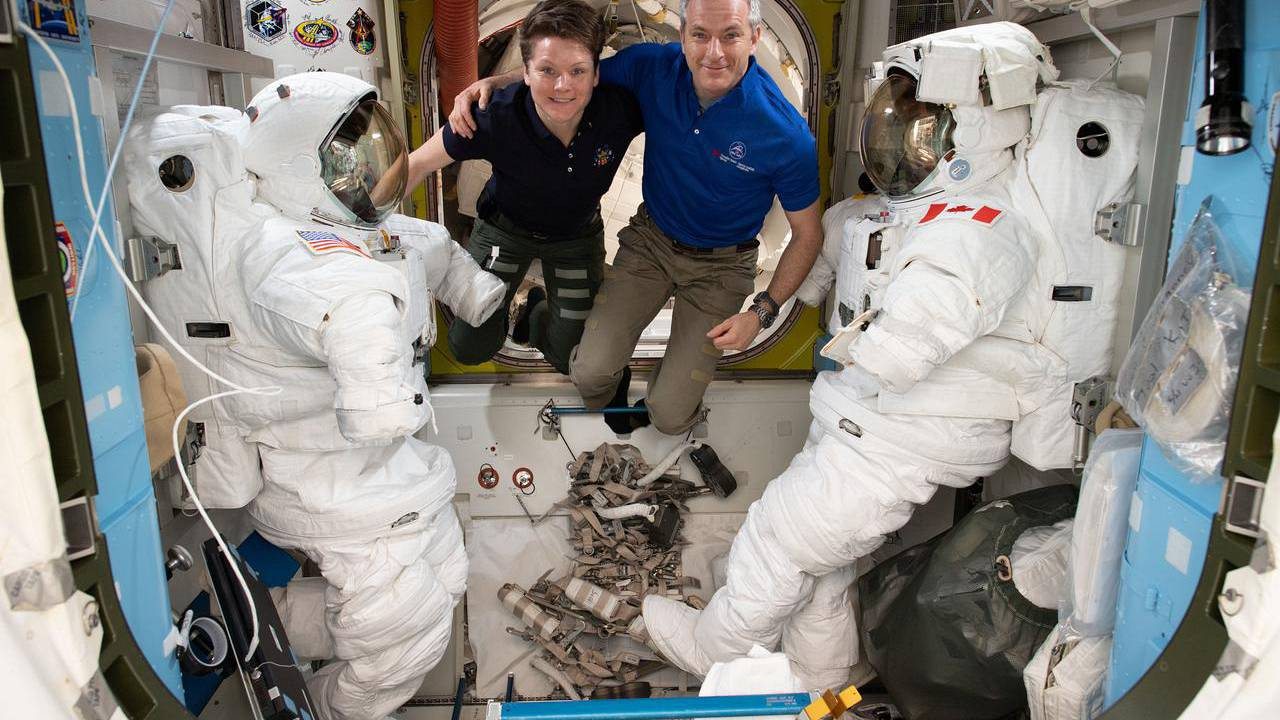 Image: Astronauts Anne McClain and David Saint-Jacques are pictured in betw