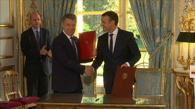 Macron recibe a Santos y le promete más ayuda para la paz
