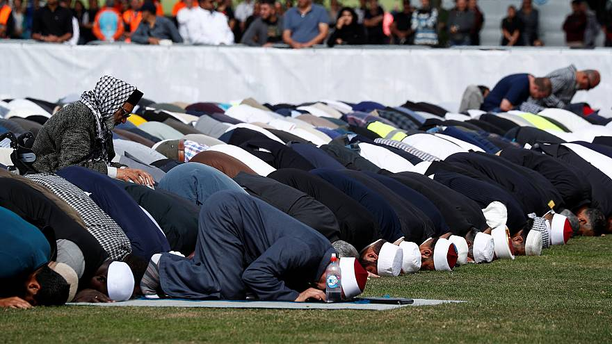Image: People perform the Friday prayers at Hagley Park outside Al-Noor mos