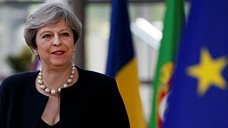 May unveils Brexit offer to UK-based EU citizens