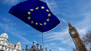 Theresa May offers post-Brexit status to EU nationals