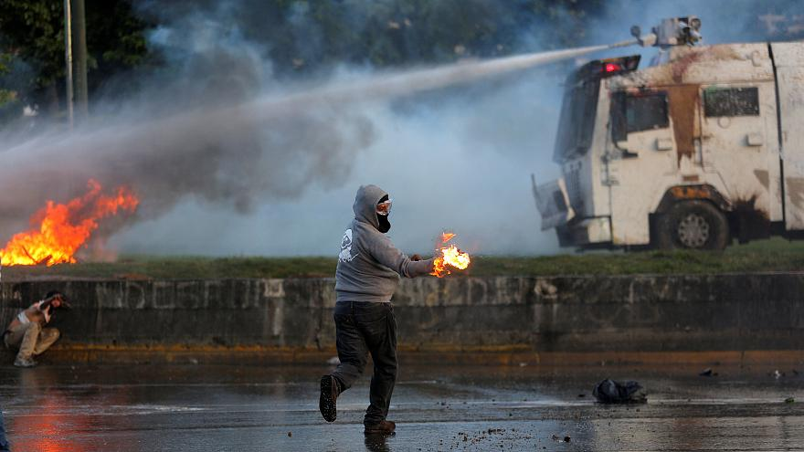 More deaths in Venezuela as anti-Maduro protesters threaten airbase