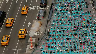 This week in pictures: heatwave in Europe and yoga in the Times Square