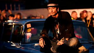 Johnny Depp makes an entrance at Glastonbury