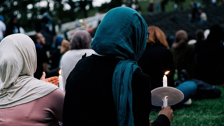 Image: People attend a vigil for the lives taken in the Christchurch terror