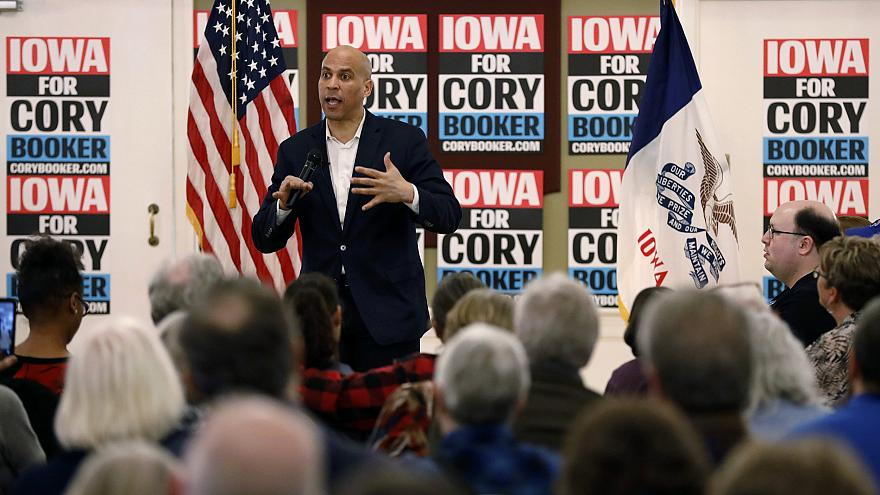 Image: Sen. Cory Booker speaks during a meeting with local residents during