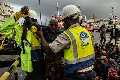 People from the town of Buzi are helped off a boat at Beira Port after being rescued on March 22, 2019 in Beira, Mozambique.