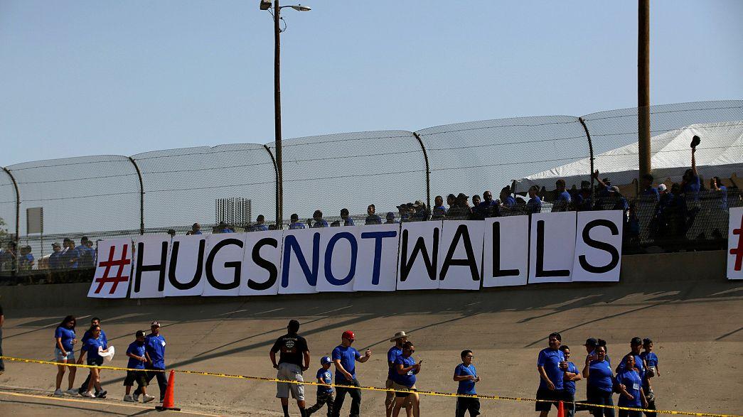 Kurze Treffen an der Mauer: #HugsNotWalls4