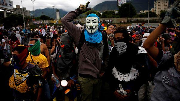 Clashes in Caracas as Venezuela opposition rally over activist's death