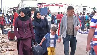 Syrian refugees return home from Turkey for Eid
