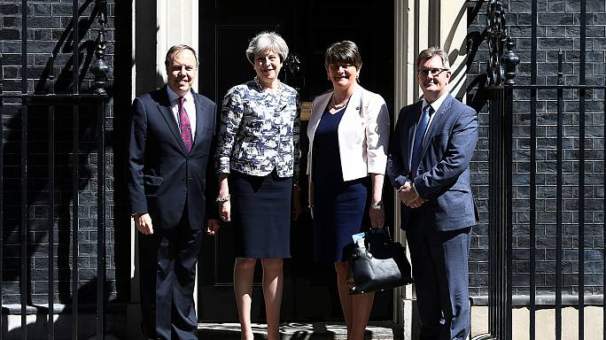 Theresa May and DUP strike deal for minority UK government
