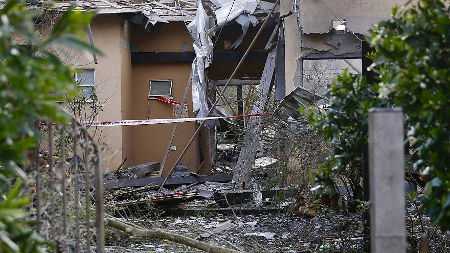 Image: Damage to a house hit by a rocket in Mishmeret, central Israel