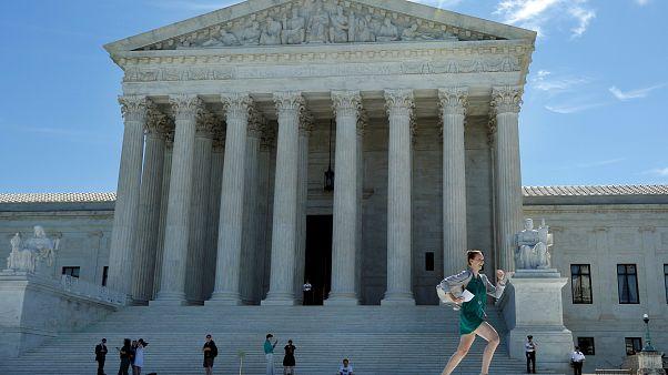 US Supreme Court revives parts of Trump's travel ban