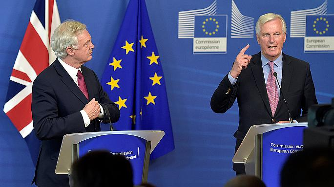 EU's Barnier cool on PM May's offer for expats