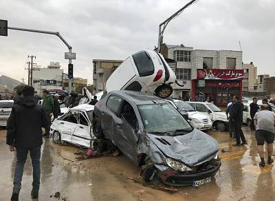 Vehicles are piled up on a street after a flash flood in the southern city of Shiraz, Iran, on March 25, 2019.