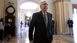 Image: Senate Majority Leader Mitch McConnell walks to the chamber at the C