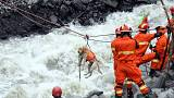 Sniffer dogs join search for missing in China landslide