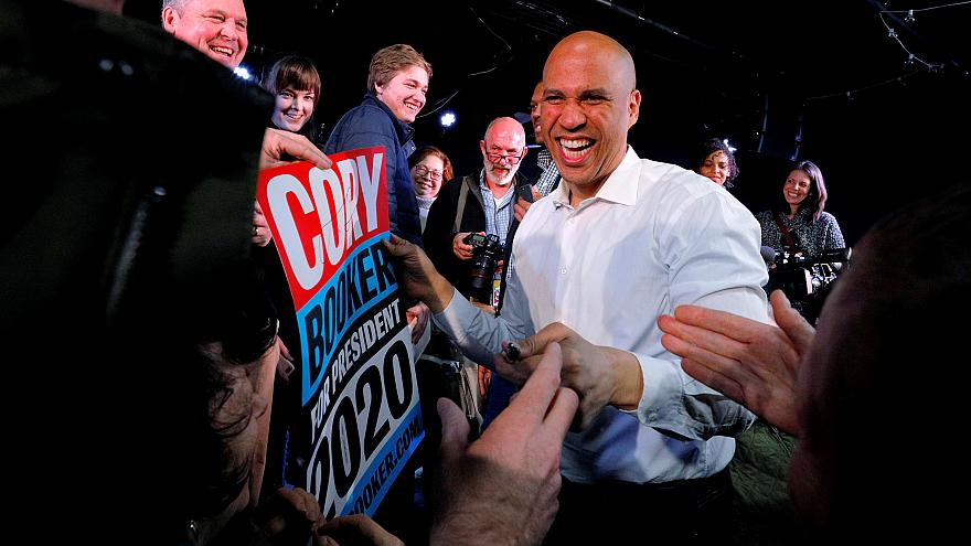Image: Sen. Cory Booker, D-NJ, greets audience members at a campaign stop i