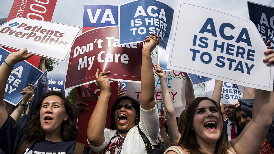 Image: Supporters of the Affordable Care Act celebrate after a Supreme Cour