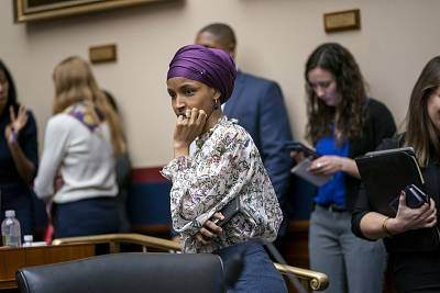 Rep. Ilhan Omar, D-Minn., arrives at the House Education and Labor Committee during a bill markup, on Capitol Hill in Washington, Wednesday, March 6, 2019.