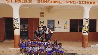 Arsenal star Welbeck in native Ghana, visits school his mom helped build