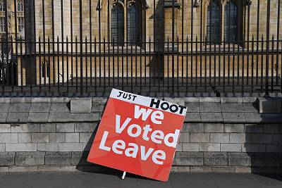 Placards supporting both sides of the Brexit debate line the sidewalks outside the Houses of Parliament in London.