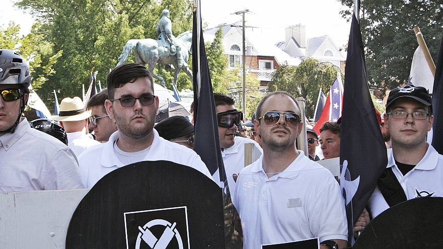 Image: James Alex Fields Jr., second from left, holds a black shield during