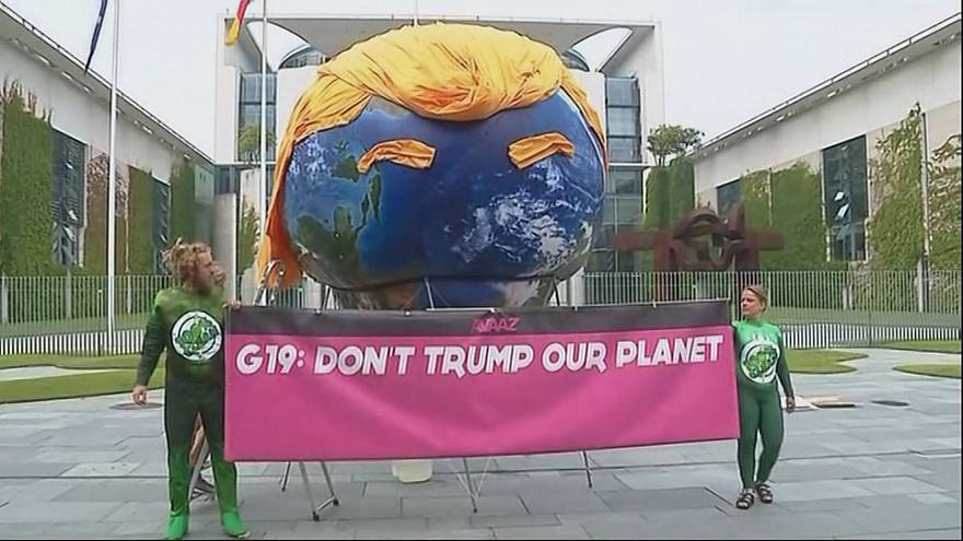 Demo in Berlin calls on Merkel to stop US derailing climate change policy