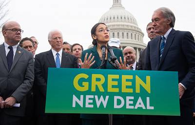 Representative Alexandria Ocasio-Cortez and Senator Ed Markey speak during a press conference to announce Green New Deal legislation to promote clean energy programs outside the US Capitol in Washington, DC.